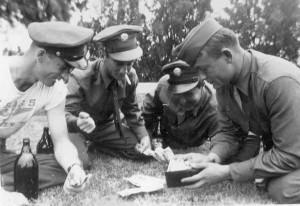 ?, Bill Garrity, ? & Bill Knowles shooting Craps C.A.A.B. 1943