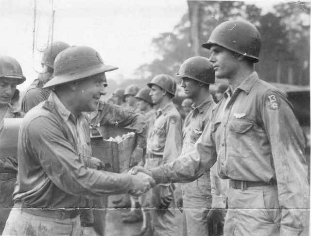 Brig. Gen. Earl W. Barnes awards Air Medal to Sgt. Wayne A. Gray, Mar Air Field, Sansapor, New Guinea